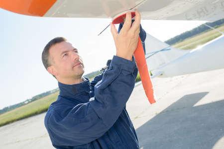 avionics: engineer fixing an airplane wing