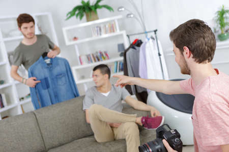 cloths: photographer chosing cloths for photo-shooting Stock Photo