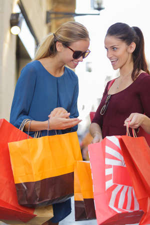 explored: young happy and wealthy women shopping