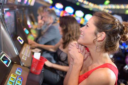 brunette girl winning in a casino Reklamní fotografie