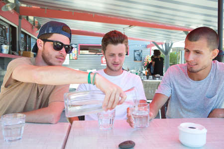 quench: three happy friends drink water to quench their thirst