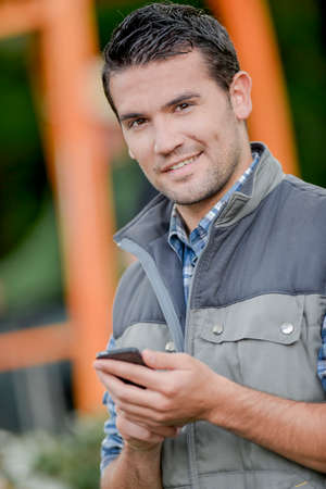 mobile telephone: Man outdoors holding mobile telephone Stock Photo