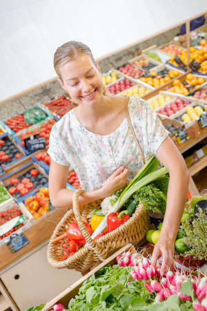 dirty blond: Woman buying some radishes Stock Photo