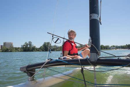 lifevest: enjoying extreme sailing with racing sailboat Stock Photo
