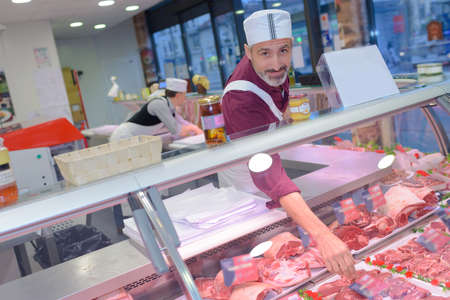 congenial: Butcher leaning into counter