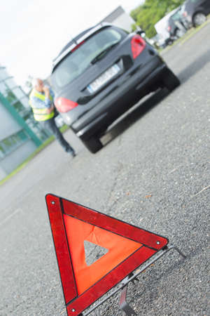 warning triangle: warning triangle behind stalled car Stock Photo