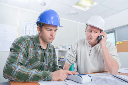 collaborator: Architects crunching some numbers Stock Photo