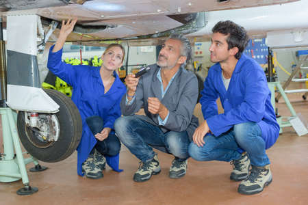 undercarriage: Students looking at aircraft undercarriage Stock Photo
