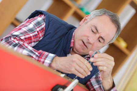 man using screw driver