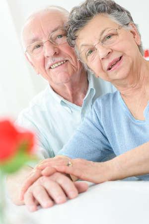 seventy: closeup of happy healthy senior couple in love