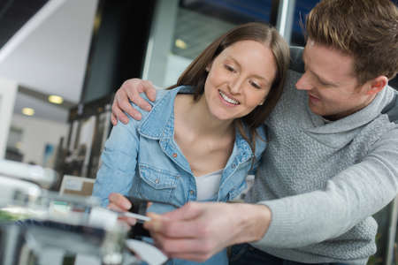 kinescope: young couple fixing a devise at home