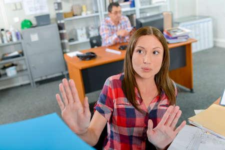 spurn: Lady at desk rejecting files