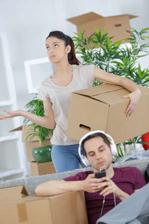 couple talking about thir new house after moving Stock Photo