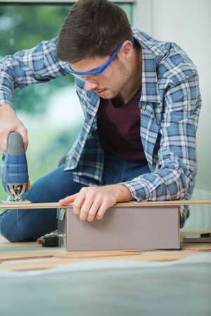 man with electric drill Stock Photo