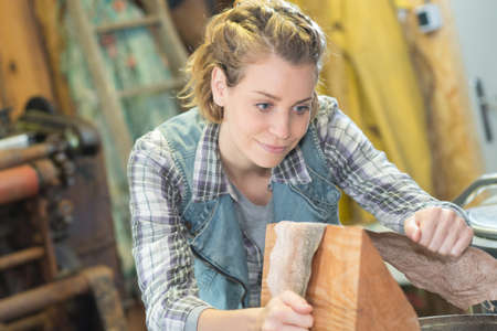 sanding block: woman hold the sanding paper with wood block