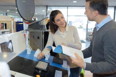 satelite: Shop assistant demonstrating satelite navigation device