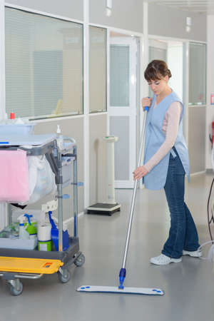 bioclean: floor care cleaning services with washing mop in clean hospital