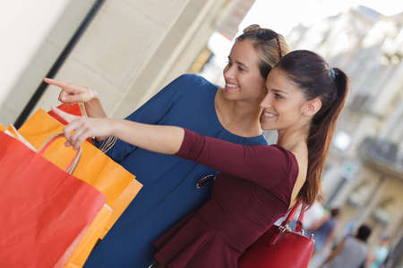 dirty blond: young happy and wealthy women shopping