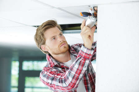 wall socket: electrician wiring a new build Stock Photo