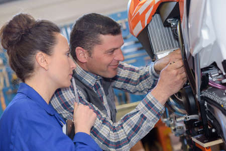 carburetor: mechanic repairs the carburetor of his motorcycle