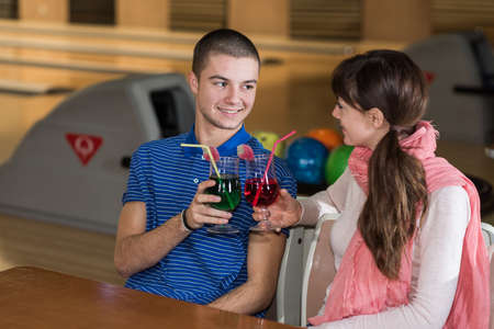 peer to peer: young couple in bowling club having fun together