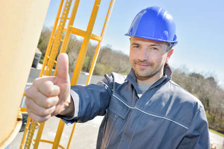 engineer with thumb up sign outdoors