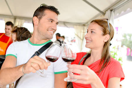 Couple tasting wine at an event Stock Photo