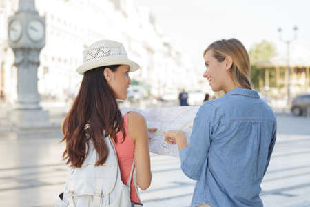 explores: young beautiful woman travelers exploring the city