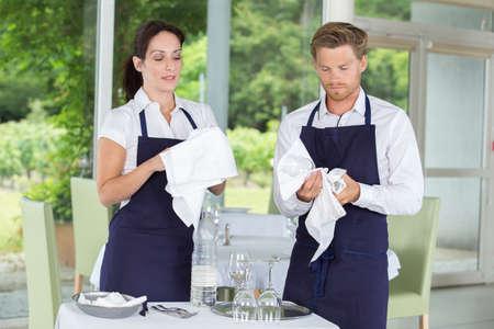restaurant staff: restaurant staff cleaning wine glasses Stock Photo