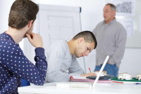 teacher explaining something to students