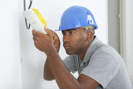 contracting: repairing household power changing a light switch