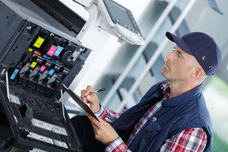 handyman fixing the office printer Standard-Bild