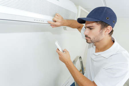 technician checking ac installation in clients building