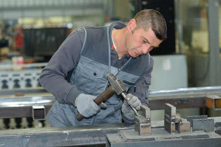 work worker: worker doing metal work in factory