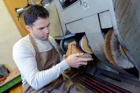 cobbler: cobbler polishing a shoe