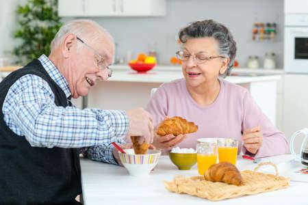 woman eat: retirement senior couple lifestyle living concept