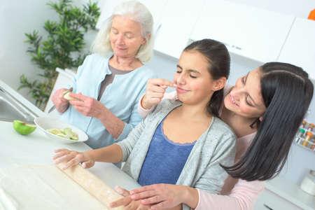 three generations: three generations of women baking together
