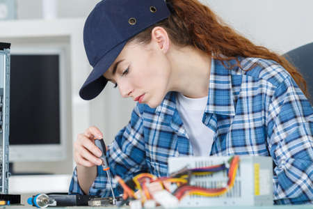 technically: Female computer technician at work