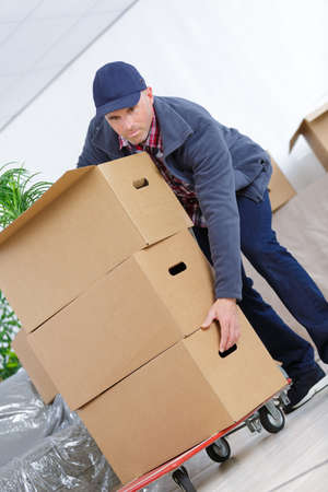 cardbox: delivery man with a lot of cardbox package