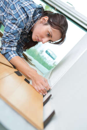 wood flooring: woman laying wood flooring