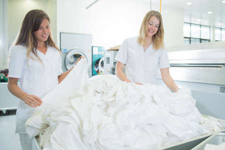 laundry room: two women working in a laundry room