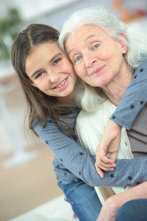 grandaughter: grandaugther hugging grandmother