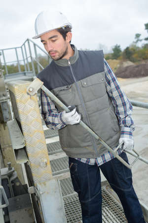 worker installing a machine outdoors Stock Photo