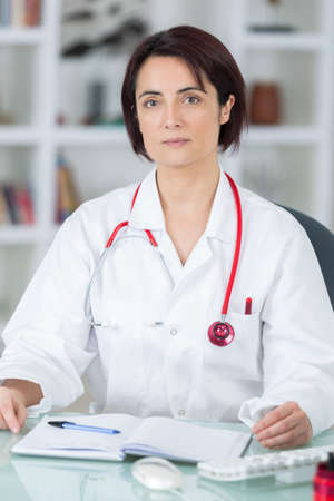 portrait of young female doctor in her office Stock Photo