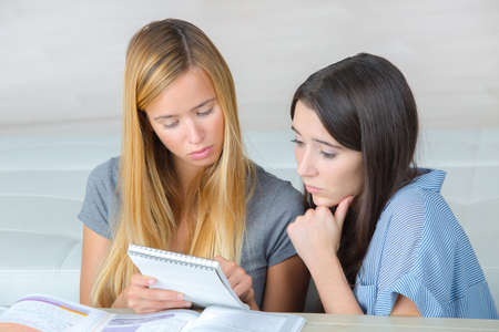 memorize: worried student trying to memorize a lesson with a friend