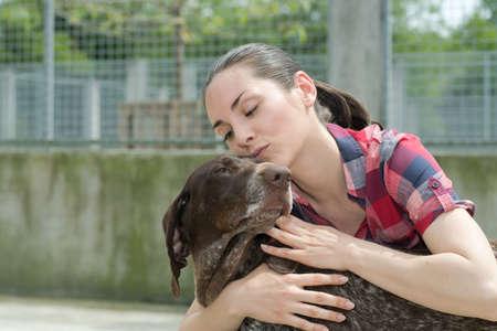 trusting: shelter keeper loves her residents