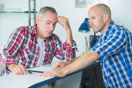 resolving: construction manager resolving a problem with colleague