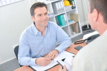 man with client in office Stock Photo