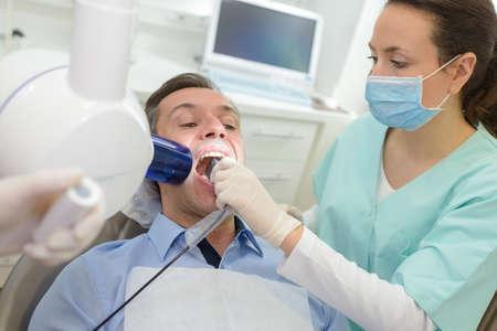 roentgenogram: dentist doing digital xray in dentist office Stock Photo