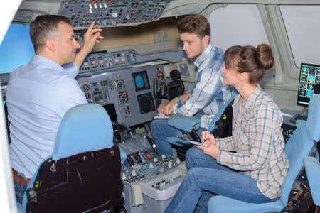 simulator: Young people visiting an aircraft simulator Stock Photo